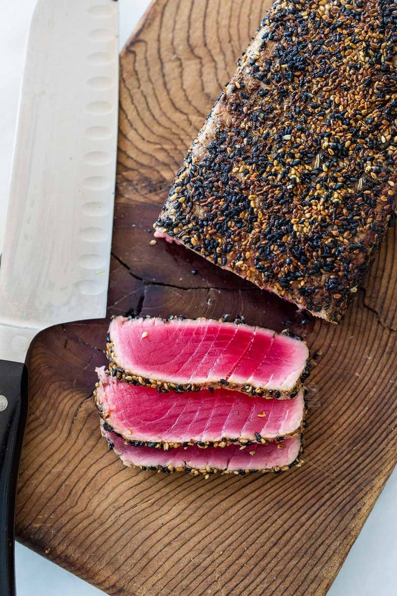 Seared Tuna with Sesame Seed Crust. Learn how to make the best Sesame Crusted Ahi Tuna- crispy golden on the outside and rare on the inside in just 10 minutes flat!