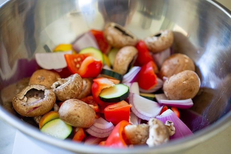 seasoning the veggies in a bowl