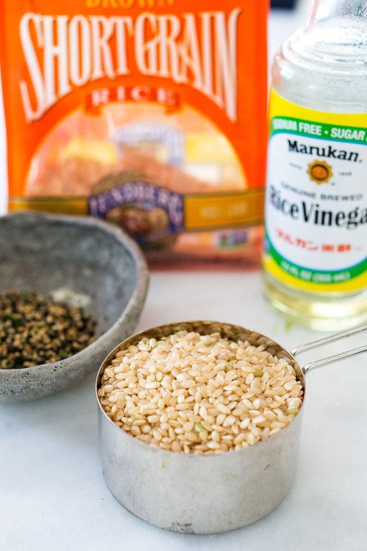 Ingredients in Japanese rice- short grain rice, rice vinegar, Furikake and scallions