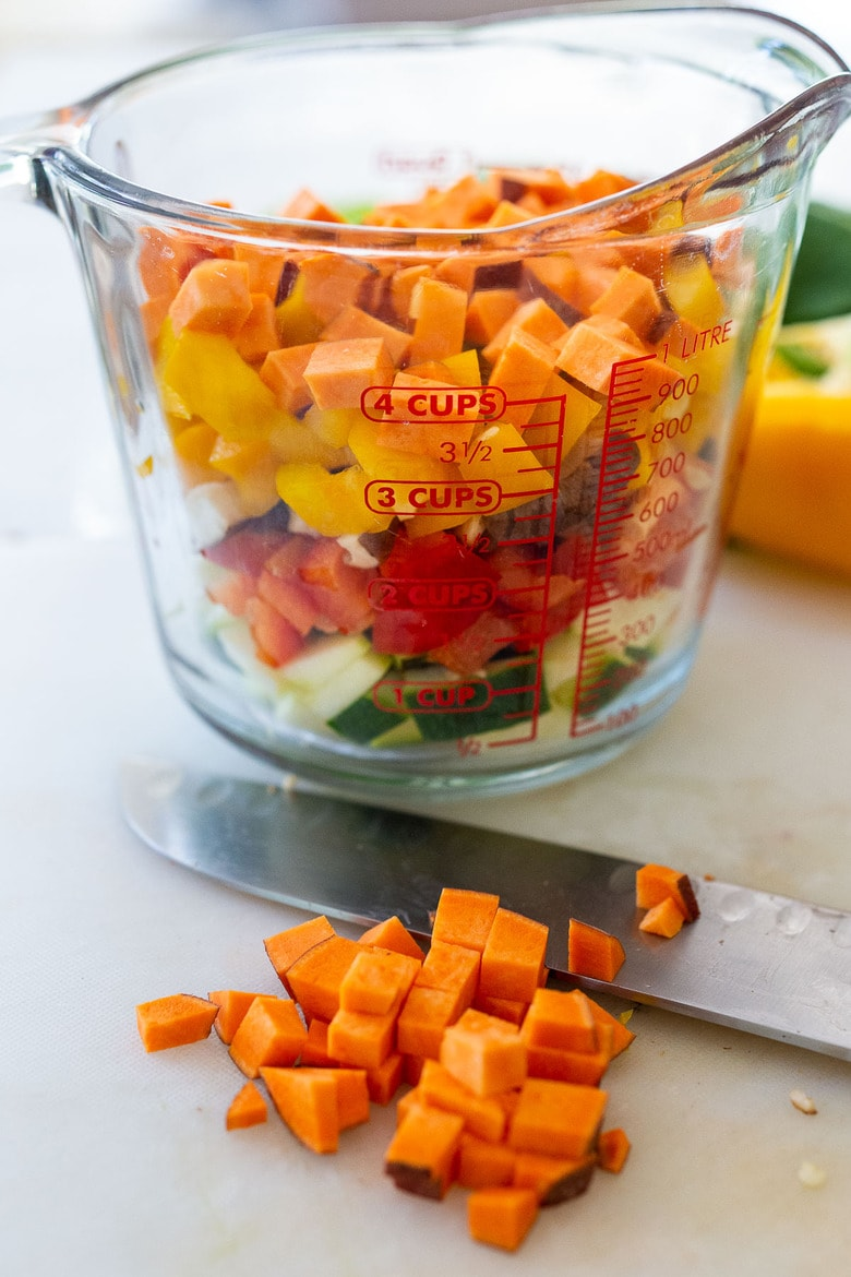 four cups of finely chopped veggies in a measuring cup