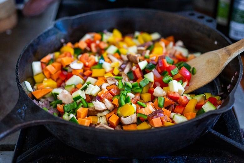 veggies sautéing in a pan