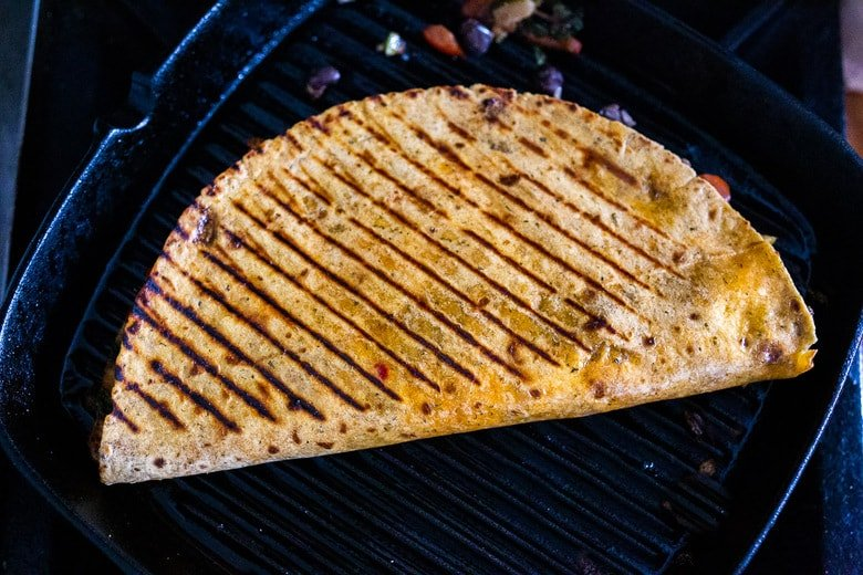 quesadilla grilling in a grill pan