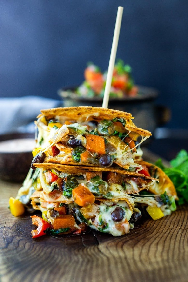 Vegetarian Quesadillas with black beans and farmer's market veggies like bell peppers, zucchini, sweet potato and greens.Easy, healthy and full of delicious Mexican Flavors! Vegan-adaptable and Gluten-free adaptable!