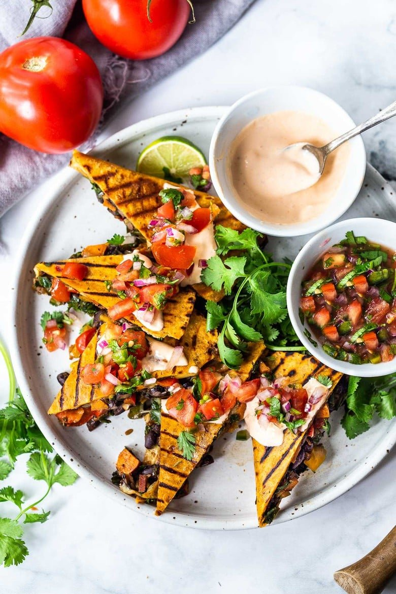 Farmers Market Veggie Quesadillas with black beans and farmer's market veggies like bell peppers, zucchini, sweet potato, greens, and melty cheese (optional) seasoned with Mexican spices. Vegan-adaptable and Gluten-free adaptable!