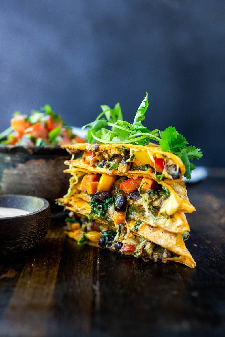 Vegetarian Quesadillas with black beans and farmer's market veggies like bell peppers, zucchini, sweet potato, greens, and melty cheese (optional) seasoned with Mexican spices. Vegan-adaptable and Gluten-free adaptable!