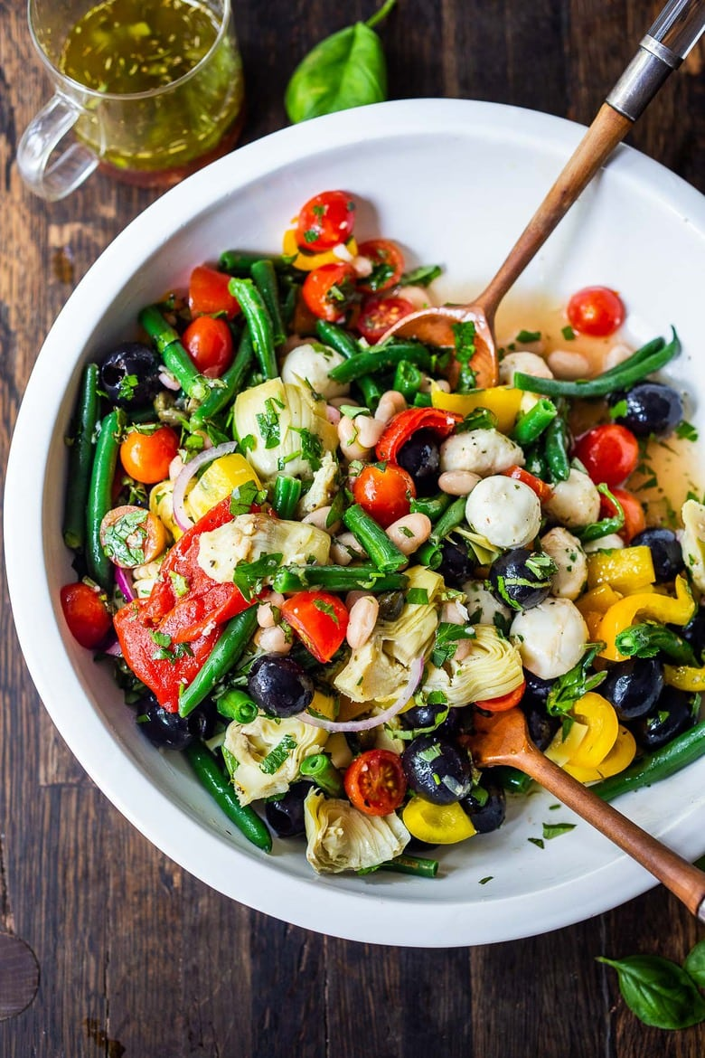 A vegetarian Antipasto Salad with made with Pantry ingredients, fresh veggies, and lots of herbs, tossed in a simple Italian dressing. Vegan and Low Carb. #antipasta #antipastasalad