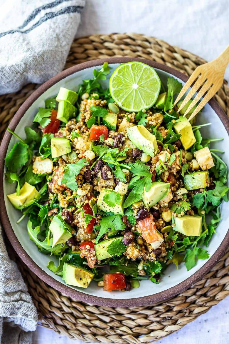 This Black Bean Quinoa Salad is quick and easy to put together and full of fresh Southwest flavors- perfect for casual summer gatherings, potlucks and bbqs. Vegan and Gluten-Free!