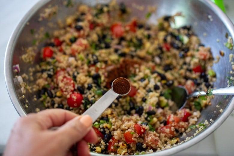 season the black bean quinoa salad with chipotle powder for smoky heat
