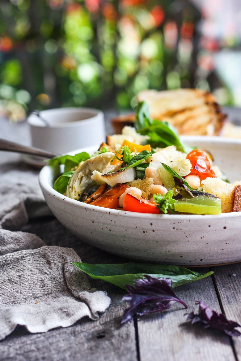 Delicious Grilled Tuscan Bread Salad with colorful sweet bell peppers, artichoke hearts and white beans tossed in a flavorful white balsamic dressing. Make it on thebarbecue for an easy outdoor summer meal with your favorite grilled protein! Vegan!