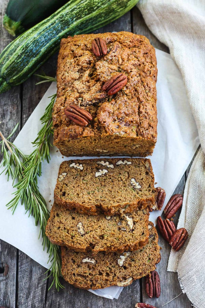 This healthy wholesome Zucchini Bread is tender and full of flavor. Made with whole wheat pastry flour and coconut sugar with a touch of orange and rosemary, packing a whole pound of zucchini in one loaf!