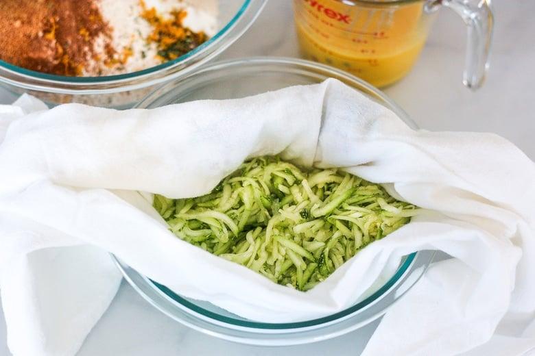 grated zucchini in a dish towel
