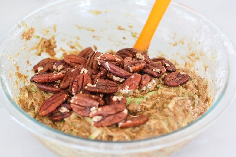 mixing dough together with pecans