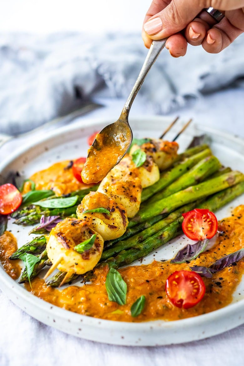 Grilled Scallops, marinated with olive oil, orange zest, coriander, salt and pepper, topped with Charred Tomato Vinaigrette. A delicious summer dinner that is fast, easy, light, refreshing and elegant! #grilledscallops