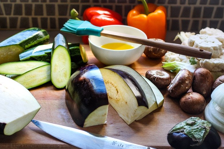 cutting and oiling veggies