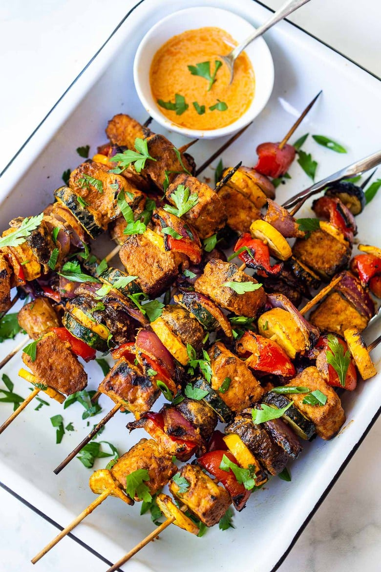 Grilled Veggie Kabobs with Harissa Yogurt -made with your choice of protein (tempeh, tofu,or chicken)! A delcious summer meal that packs a big punch of flavor! Perfect for summer bbqs and gatherings! Vegan-adaptable.