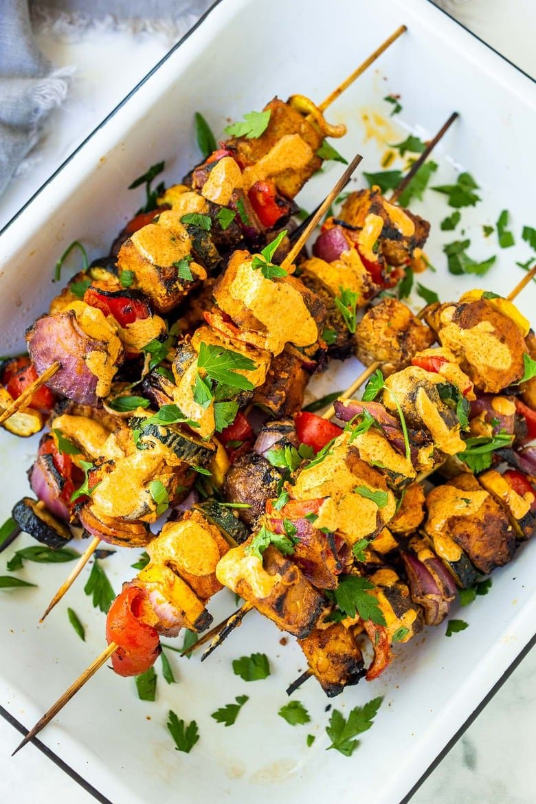 Grilled Veggie Kabobs with Harissa Yogurt -made with your choice of protein (tempeh, tofu,or chicken)! A delcious summer meal that packs a big punch of flavor! Perfect for summer bbqs and gatherings! Vegan-adaptable.#kababs #veggiekabobs, #veganskewers, #veggieskewers #harrissakabobs