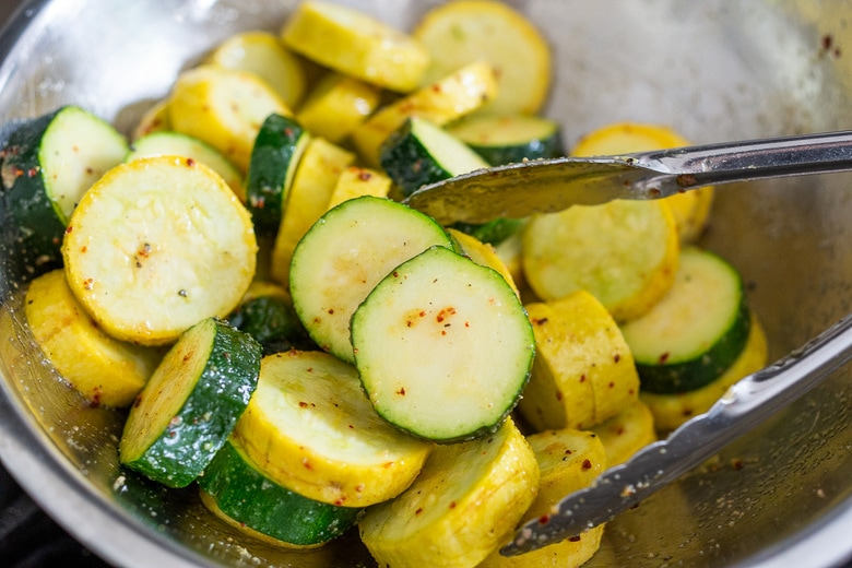 toss the zucchini with olive oil, salt, pepper and chili flakes