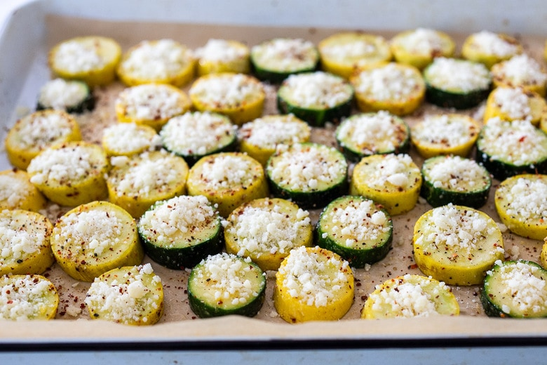 sprinkle the zucchini with parmesan or pecorino cheese