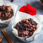 Double Chocolate Zucchini Muffins with Dried Cherries have a hint of spice and are richly satisfying -a delicious treat with a bit of healthy tucked inside!