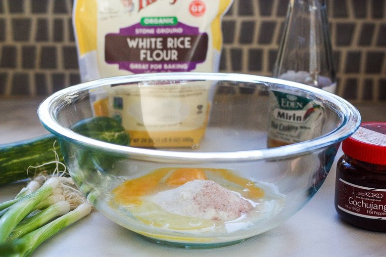 mixing eggs and rice flour to make the scallion pancake batter