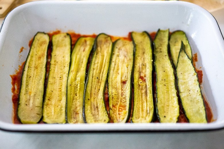 first layer of zucchini over the sauce.