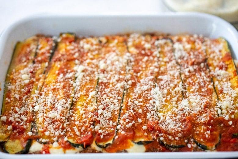Final layer of marinara over the zucchini, sprinkled with pecorino.