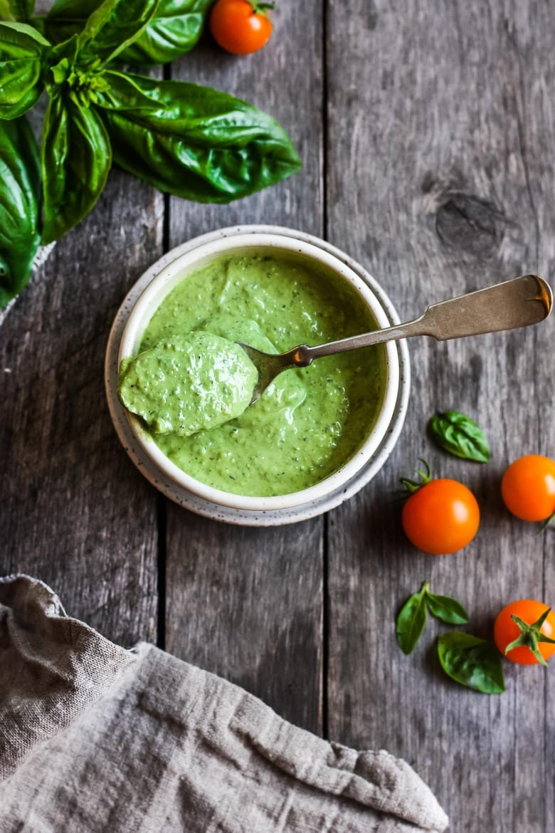 Creamy Pesto Dressing is a rich and vibrant compliment to so many dishes. Simple to make with just 5 ingredients. Perfect for pasta salads, sandwiches and dip. Vegan adaptable.