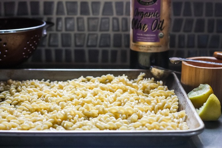pasta cooling on a sheet pan