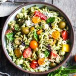Pesto Pasta Salad w/ cherry tomatoes, baby mozzarella, olives & fresh basil tossed in a Creamy Pesto Dressing. Vegan, gluten-free adaptable.