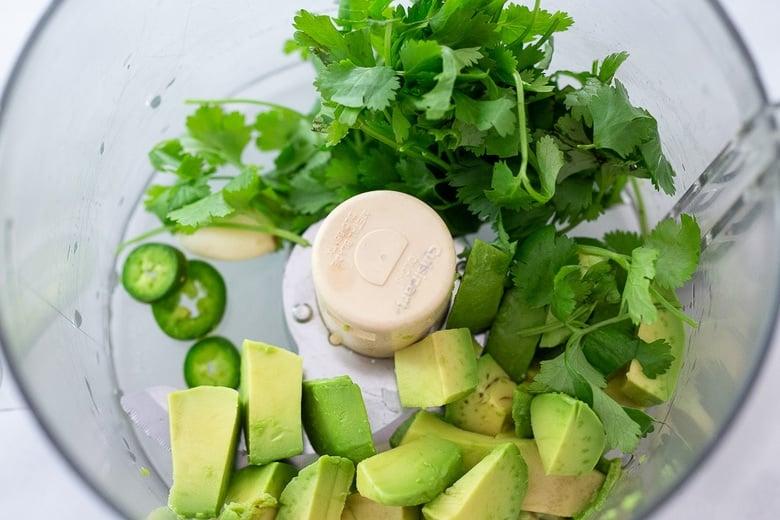 avocado, cilantro, garlic, jalapeno in a blender