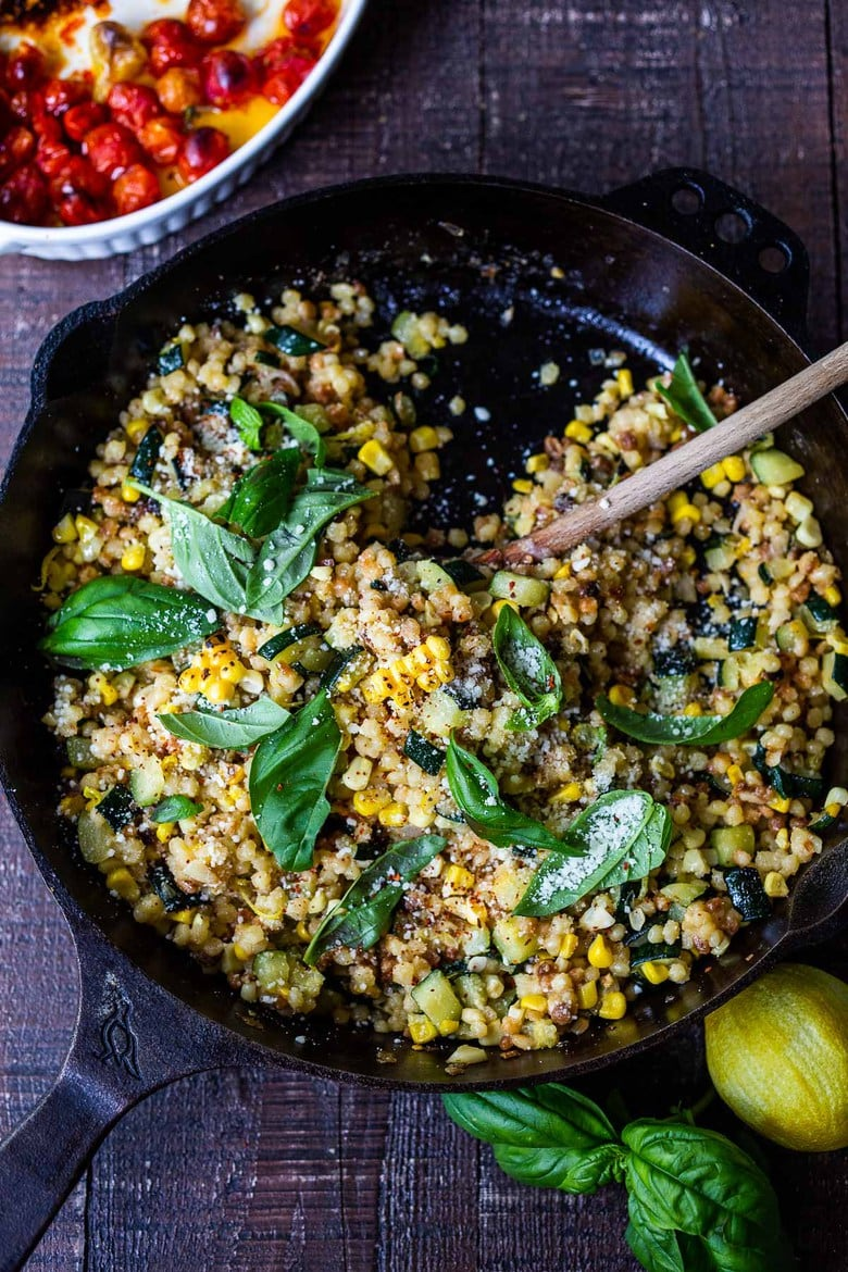Fregola Sarda with Corn, Zucchini and Basil, sprinkled with pecorino. A fast and easy Italian-inspired meal that comes together in 30 minutes.
