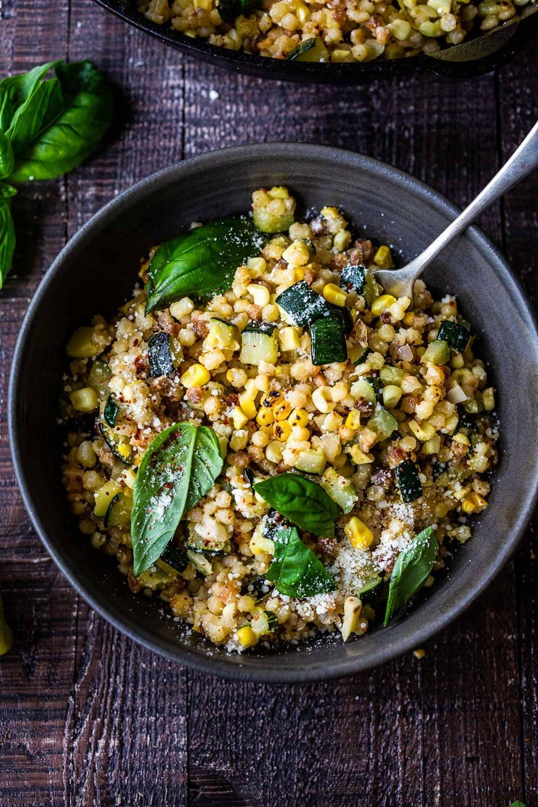 Fregola recipe with Corn, Zucchini and Basil, sprinkled with pecorino. A fast and easy Italian-inspired meal that comes together in 30 minutes.