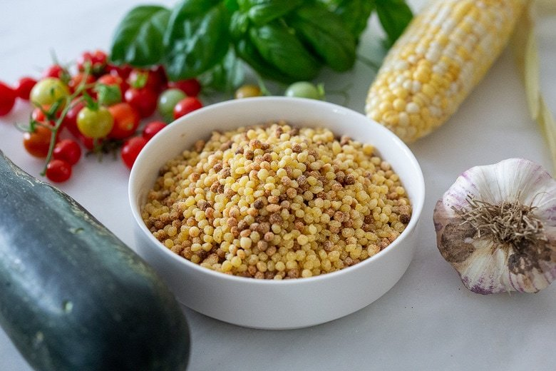 Ingredients in Fregola Sarda with Corn, zucchini, basil and pecorino