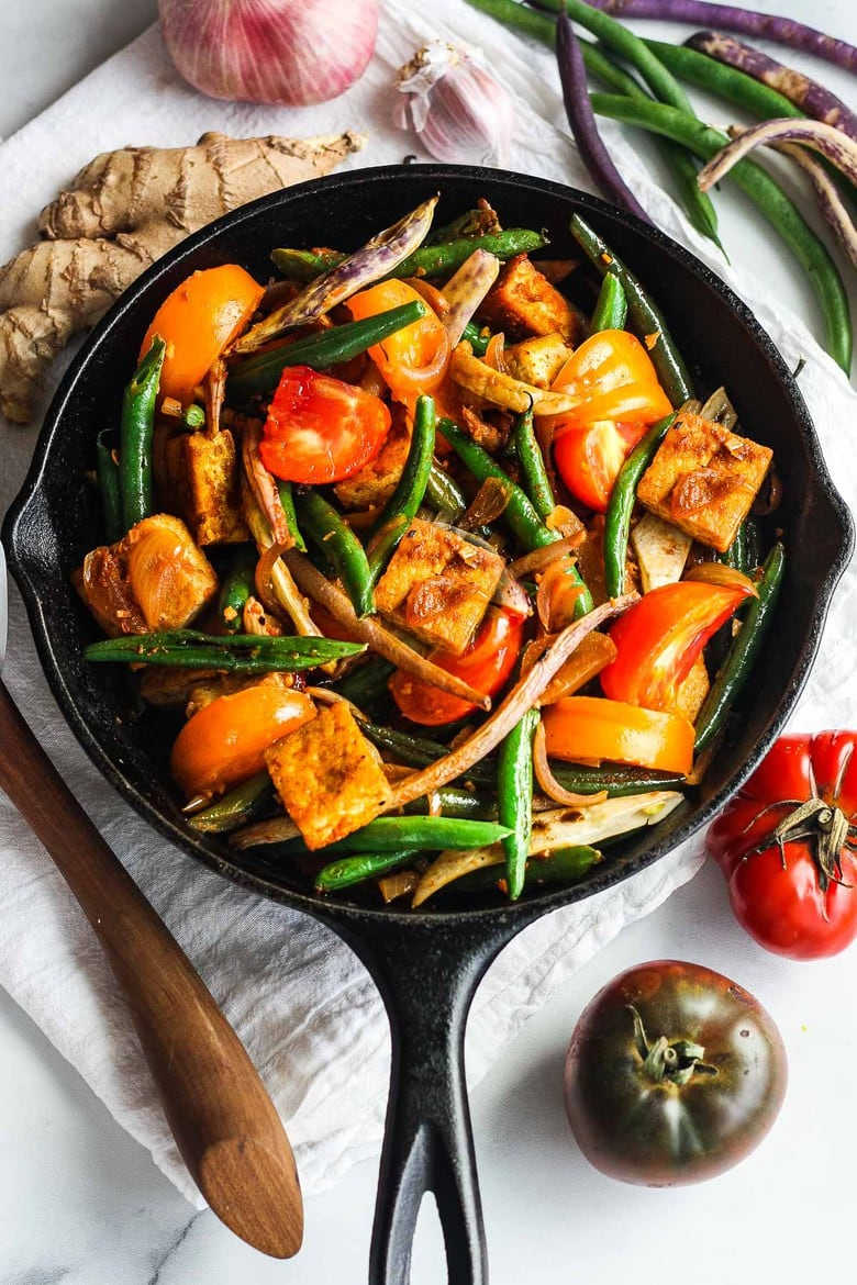 Green Bean andTofu Stir Fry is full of crunch and flavor.  Spiced up with red curry paste, shallots, ginger and lemongrass for a quick, savory Thai-inspired meal.  Vegan and GF.