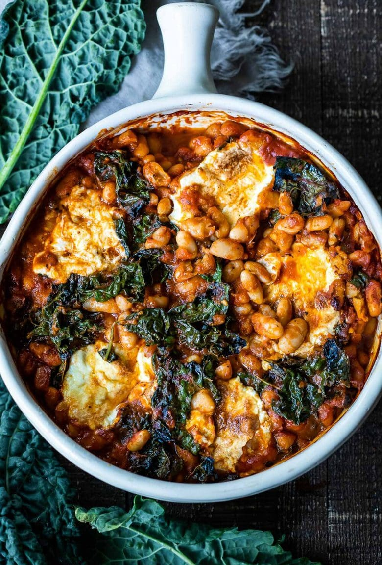 A simple recipe for Italian Baked Beans, made with cannellini beans, kale, and your favorite homemade (or store-bought) Marinara sauce, andbaked in the oven until golden and bubbling. A delicious vegetarian main!