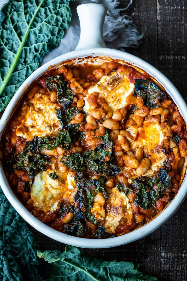 Italian Baked Beans, made with cannellini beans, kale, and your favorite homemade (or store-bought) Marinara sauce, andbaked in the oven until golden and bubbling. A delicious vegetarian main!