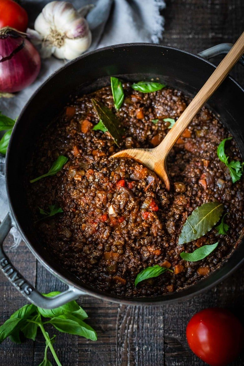 """Rich and robust, this plant-based Lentil Bolognese is hearty, """"meaty"""" and full of depth of flavor. Toss it with your favorite pasta, or spoon it over creamy polenta- either way, this simple nourishing vegan meal is one the whole family will enjoy. #lentilbolognese"""