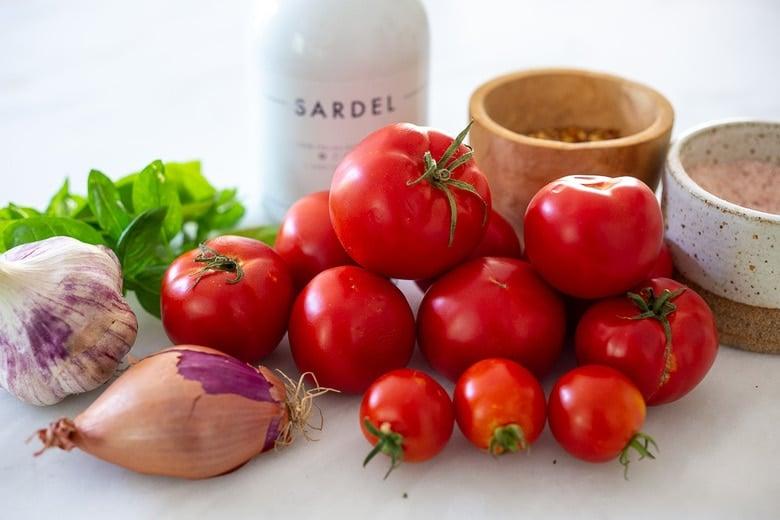 Ingredients in marinara sauce- tomatoes, garlic, onions or shallots, olive oil, oregano and fresh basil