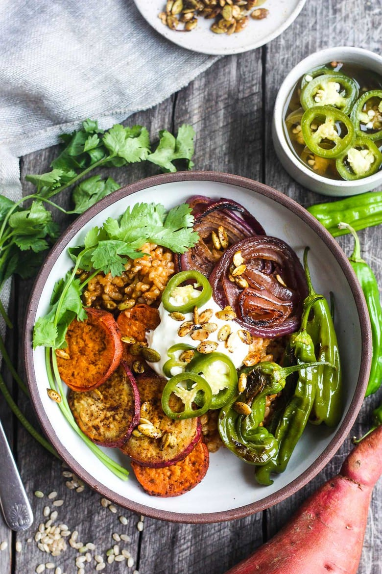 This healthier Mexican Rice is made with brown rice and topped with roasted veggies. A delicious comforting vegan meal, bursting with flavor!