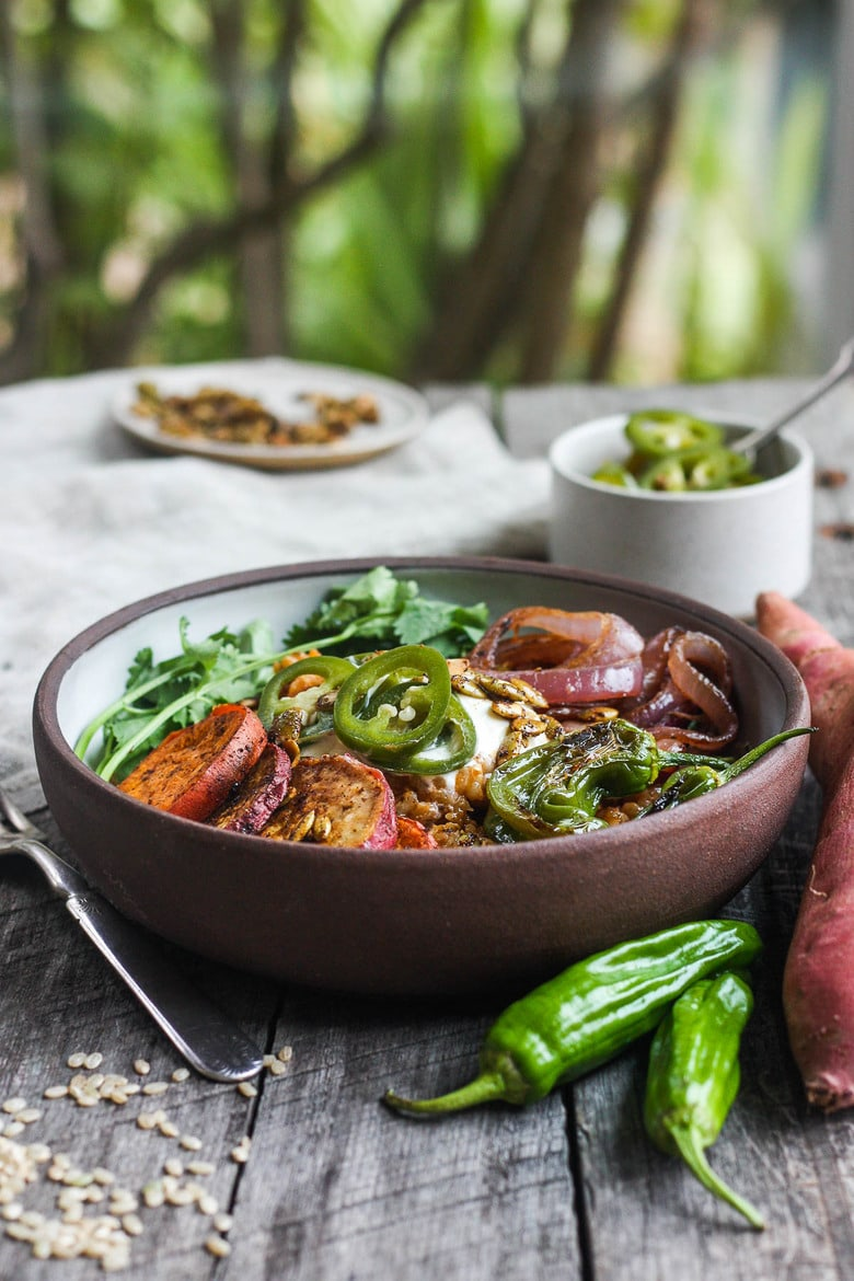 Healthy and flavorful Mexican Rice made with brown rice, topped withsheet-panroasted yams, red onions, and shishito peppers. Top with pickled jalapeños and pumpkin seeds for a comforting delicious vegan meal. #mexicanrice