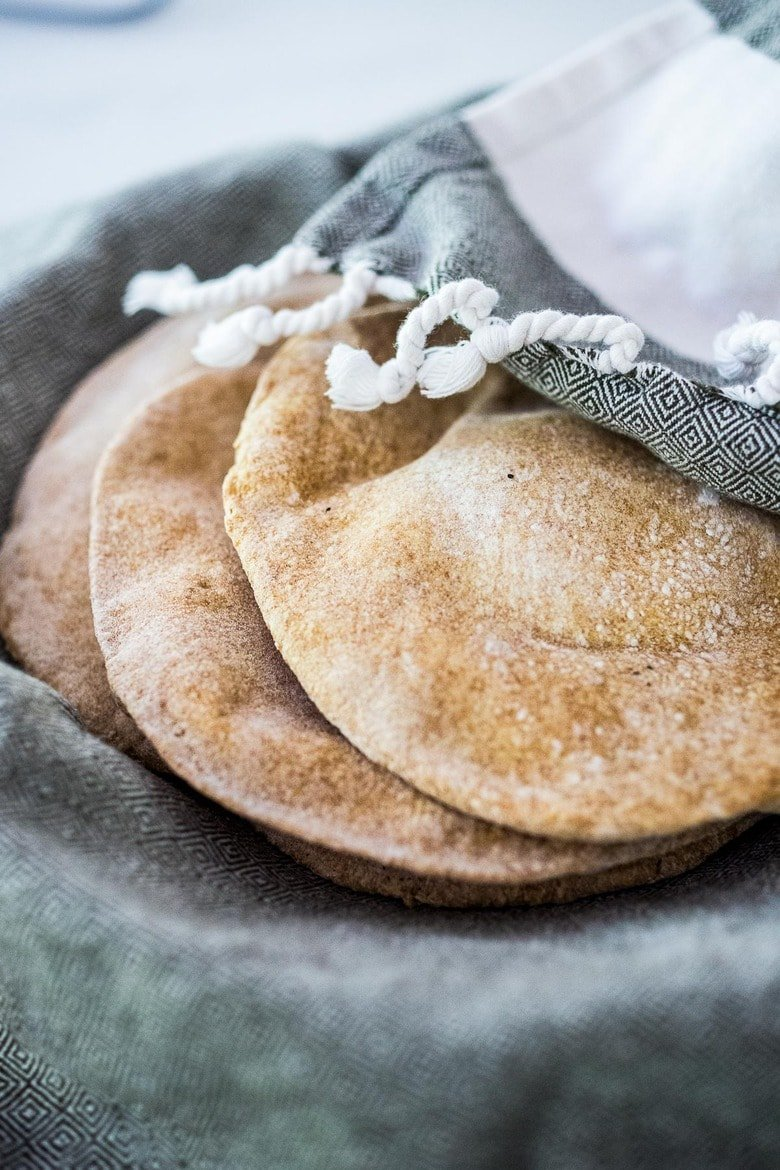 How to make homemade pita bread- a simple step by step recipe that turns out perfect every time! #pitabread #pitarecipe #bestpitabread #easypitabread