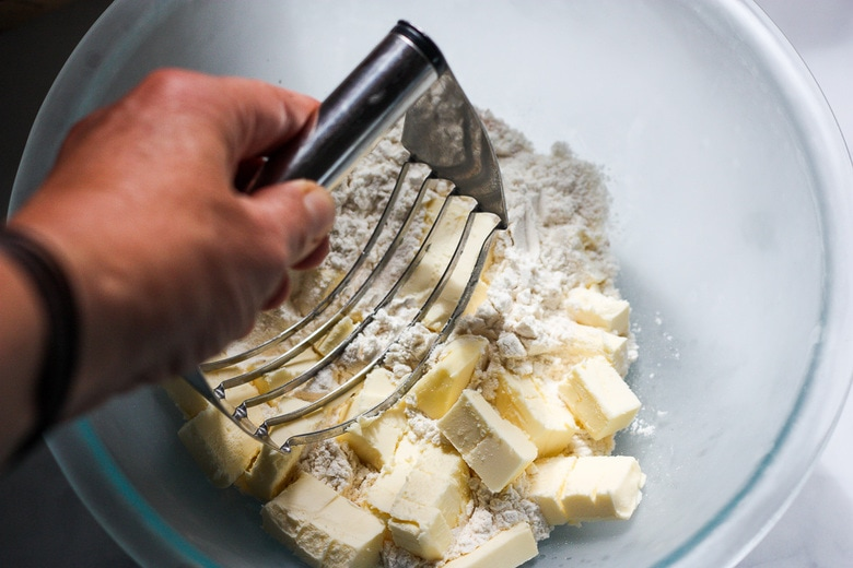 cutting butter into the flour