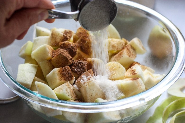 mixing apples with spices and sugar