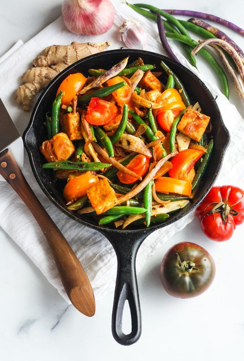 Thai Green Bean andTofu Stir Fry is full of crunch and flavor.  Spiced up with red curry paste, shallots, ginger and lemongrass for a quick and savory 30 minute meal.  Vegan and GF.