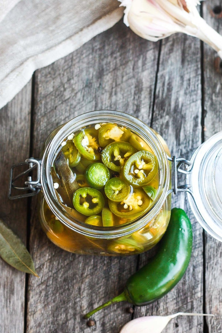 How to make easy homemade Pickled Jalapeños -a deliciously tangy, sweet and spicy accent to tacos, burgers, soups, burritos, and more!