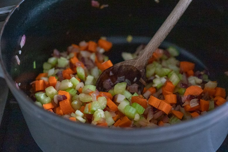 adding carrots, celery and garlic