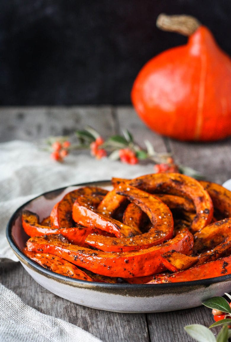 Tender and delicious Roasted Red Kuri Squash baked with an ancho chili powder -maple rub. A perfect fall and winter side dish. Easy to make with very little hands-on time. Vegan and Gluten-free.
